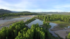 Gorgeous drone view of mountains and forest by river on a sunny day Stock Footage