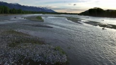 Drone view of sunset sky wth snowcapped mountains and river 8 Stock Footage