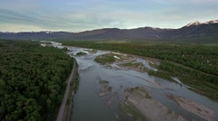 Drone view of river and forest by majestic mountains Stock Footage
