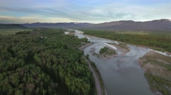 Drone view of river and forest by majestic mountains 2 Stock Footage