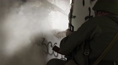 Soldier firing out of a hole in building Stock Footage