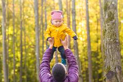 Family, childhood, fatherhood, leisure and people concept - happy father and Stock Photos