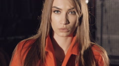 Sexy model in red coat flirting and catwalking. Slowly Stock Footage