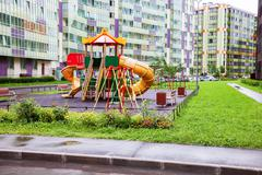 Colorful children's playground for kids in new district Stock Photos