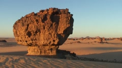 View over rock formations in sandy Wadi in the Saharan desert in the morning Stock Footage