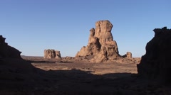 View over rock formations in stony Saharan desert in the afternoon sun Stock Footage