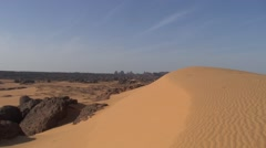 View over sandy rocky Wadi on a sunny day in the Saharan desert Stock Footage