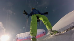 POV from front of ski of man soaring through the air as he goes speed riding fly Stock Footage
