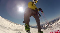 Man preparing parachute to go speed riding flying on snow covered mountain. Stock Footage