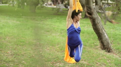 Aerial Yoga or practicing yoga in the air. Stock Footage