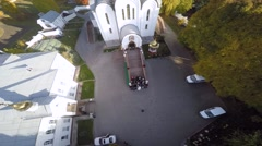 Newlyweds gather outside Orthodox church aerial view Stock Footage