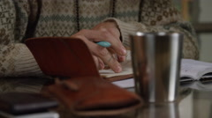 Backpacker travel journal in coffee shop Stock Footage