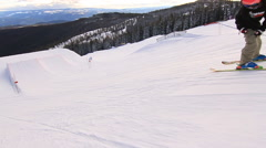 A man skiing down a snow-covered mountain in the winter, slow motion. Stock Footage