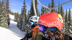 A group of skiers riding the chair lift up a mountain. Stock Footage