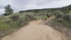 A man riding his mountain bike. Stock Footage