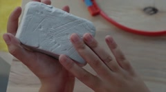 Children's hands sculpts clay crafts pottery school Stock Footage