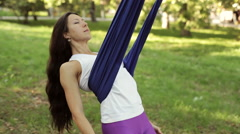 Practice of anti gravity fly yoga with hammock Stock Footage