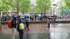 People in the rain in city. Stock Footage
