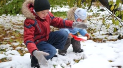 Happy children play with snow in Park Stock Footage