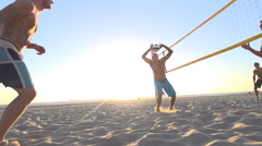 Men playing beach volleyball, super slow motion. Stock Footage