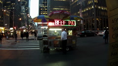 A man orders food from a hot dog food cart in New York Stock Footage