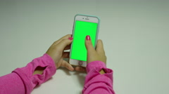 POV girl on a cellphone with green color Stock Footage