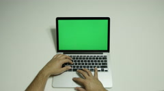 Boy on a computer trying with a green screen  Stock Footage