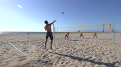 Men playing beach volleyball. Stock Footage