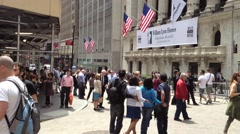 NEW YORK CITY - JULY 2013:  Tourists and business people walk and gather around Stock Footage