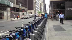 NEW YORK CITY - JULY 2013: Residents try out bike sharing program. Citi Bike is Stock Footage