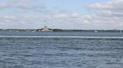NEW YORK CITY, NY - August 1, 2012:  Boats and ship traffic go by the Statue of Stock Footage
