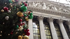 NEW YORK CITY: A Christmas tree is set up outside the New York Stock Exchange Stock Footage