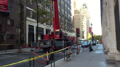 NEW YORK: Large Crane assists with construction on apartment Stock Footage