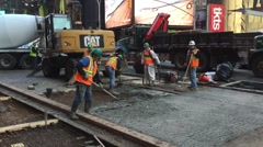 NEW YORK CITY: Construction workers lay down cement in Times Stock Footage