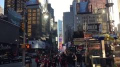 NEW YORK CITY: Pedestrians walk through theatre district.  Stock Footage