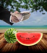 Businessman invest in fruit market concept Stock Photos