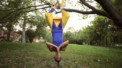 Aerial yoga practitioner stretches herself while suspended on hammock. Stock Footage