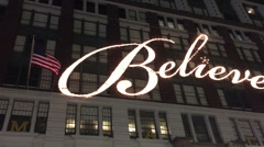 NEW YORK CITY: Macys Believe sign is lit up at flagship store Stock Footage