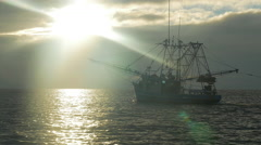 Shrimping Boat Fishing at Sunrise with Nets Stock Footage
