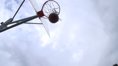 Basketball making it in basketball hoop, super slow motion. Stock Footage
