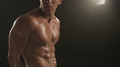 Healthy young man breathing and showing his chest muscles Stock Footage