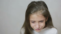 Little girl crying with tears rolling down her cheeks Stock Footage
