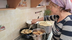 Woman Cooking Homemade In The Kitchen Stock Footage