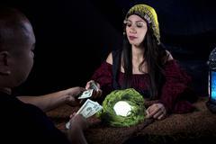 Swindler Gypsy Fortune Teller Committing Fraud Stock Photos