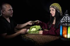 Swindler Gypsy Fortune Teller Committing Fraud Stock Photos