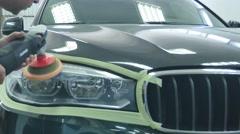 Close up car lamp or front headlight polishing, renewed headlamp Stock Footage
