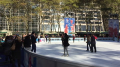 NEW YORK CITY: People skate during holidays at ice rink at Stock Footage