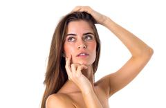 Woman touching face and holding hair Stock Photos