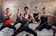 Powerful exercise with resistance band Stock Photos