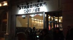 NEW YORK CITY: Night time NX establishing shot of a Starbucks Stock Footage